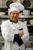 Cozinheiro chefe de sorriso no uniforme Imagem de Stock Royalty Free