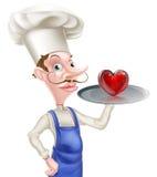 Cozinheiro chefe dos desenhos animados com coração Fotografia de Stock Royalty Free