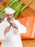 Cozinheiro chefe e comer saudável foto de stock