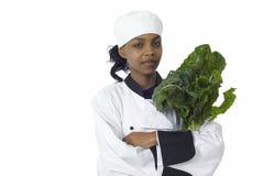 Cozinheiro chefe e espinafre fotografia de stock