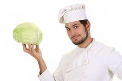 Cozinheiro chefe e repolho imagens de stock royalty free