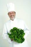 Cozinheiro chefe e salade verde Foto de Stock Royalty Free