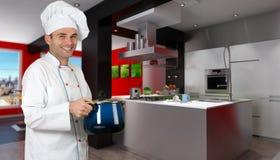 Cozinheiro chefe em uma cozinha vermelha e preta do desenhador Imagens de Stock Royalty Free