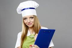 Cozinheiro chefe fêmea em poses diferentes isolado no cinza Foto de Stock Royalty Free