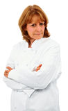 Cozinheiro chefe fêmea mais idoso atrativo com os braços cruzados Foto de Stock Royalty Free