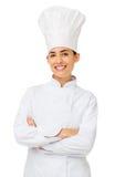 Cozinheiro chefe fêmea Standing Arms Crossed Fotos de Stock Royalty Free