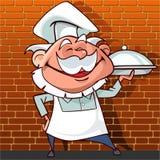 Cozinheiro chefe feliz dos desenhos animados que mantém um prato disponivel Fotos de Stock Royalty Free