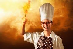 Cozinheiro chefe On Fire da mulher imagem de stock