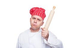 Cozinheiro chefe irritado com pino do rolo imagens de stock