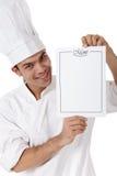 Cozinheiro chefe nepalês atrativo novo do homem, menu imagem de stock royalty free