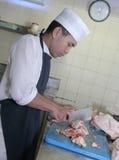 Cozinheiro chefe no carniceiro Imagem de Stock