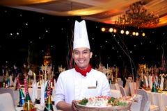 Cozinheiro chefe no jantar de gala do ano novo Fotos de Stock