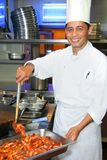 Cozinheiro chefe no trabalho Imagens de Stock Royalty Free
