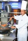 Cozinheiro chefe no trabalho Imagem de Stock