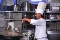 Cozinheiro chefe no trabalho Fotografia de Stock