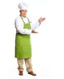 Cozinheiro chefe que convida no restaurante. fotografia de stock