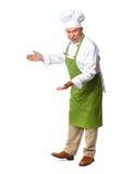 Cozinheiro chefe que convida no restaurante. imagens de stock