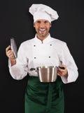 Cozinheiro chefe que cozinha com potenciômetro Fotografia de Stock Royalty Free