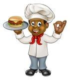 Cozinheiro chefe que guarda o hamburguer Imagem de Stock Royalty Free