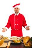 Cozinheiro chefe que mostra ao seu o trabalho Foto de Stock Royalty Free