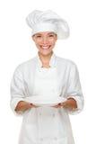 Cozinheiro chefe que mostra a placa vazia Fotos de Stock