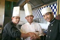 Cozinheiro chefe três Fotografia de Stock Royalty Free