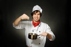 Cozinheiro com farinha Imagens de Stock