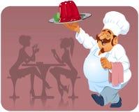 Cozinheiro com pudim da framboesa Foto de Stock