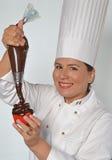 Cozinheiro da mulher da pastelaria Fotografia de Stock