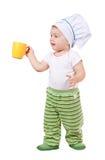 Cozinheiro do bebê no toque com copo foto de stock royalty free