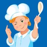 Cozinheiro do menino com uma colher em um fundo azul Imagem de Stock