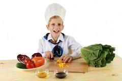 Cozinheiro feliz dos jovens Imagem de Stock