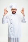 Cozinheiro masculino do cozinheiro chefe que mostra o sinal aprovado Imagem de Stock