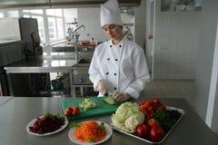 Cozinheiro na cozinha Foto de Stock Royalty Free