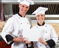 Cozinheiros chefe felizes Imagens de Stock