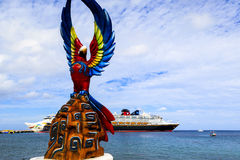 COZUMEL, MEXICO. JAN 26 2016: Statues on the sea shore promenade. View from Cozumel island, the most popular destination in Caribbean (Mexico). The economy of Stock Image