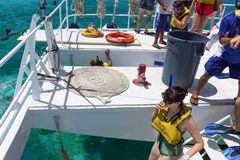 Cozumel, Mexico - May 04, 2018: The people at snorkeling underwater and fishing tour by boat at the Caribbean Sea stock images