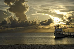 Cozumel sunset. A dive boat tied up at the pier after a day of SCUBA Diving in Cozumel Royalty Free Stock Photos