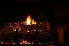 Cozy 17. Romantic fire buring in fireplace Royalty Free Stock Photography