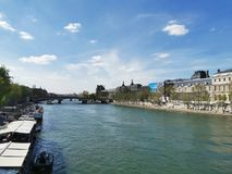 Cozy Afternoon along Seine, Paris. Enjoy the slow life in Paris, walking along the Seine on a sunny afternoon royalty free stock images