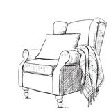 Cozy armchair and warm blanket. A cozy armchair and a warm blanket. nRelaxing atmosphere Royalty Free Stock Photography