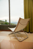 Cozy armchair at the window of mountain hotel in Sri Lanka Stock Photos
