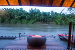 Cozy atmosphere and natural touch along Kwai Noi River,Sai Yok,Kanchanaburi,Thailand.With sofa bed on the balcony of the raft hous. Kwai Noi or Kwai Sai Yok is a stock photo