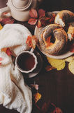 Cozy autumn breakfast at country house. With tea, bagel and seasonal decorations Royalty Free Stock Photo