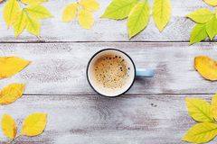 Cozy autumn breakfast with morning cup of coffee on rustic wooden table top view. Flat lay style. royalty free stock images