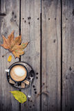Cozy autumn, cup of coffee and yellow leaves Stock Image
