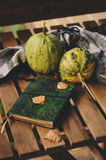 Cozy autumn morning at country house, cup of tea and warm blanket on wooden table. Still life details Stock Images