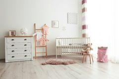 Cozy baby room interior royalty free stock images
