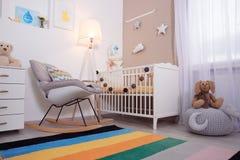 Cozy baby room interior with crib Royalty Free Stock Photos