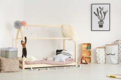 Cozy baby room in nordic design. White cozy baby room in nordic design with wooden furniture Royalty Free Stock Photo